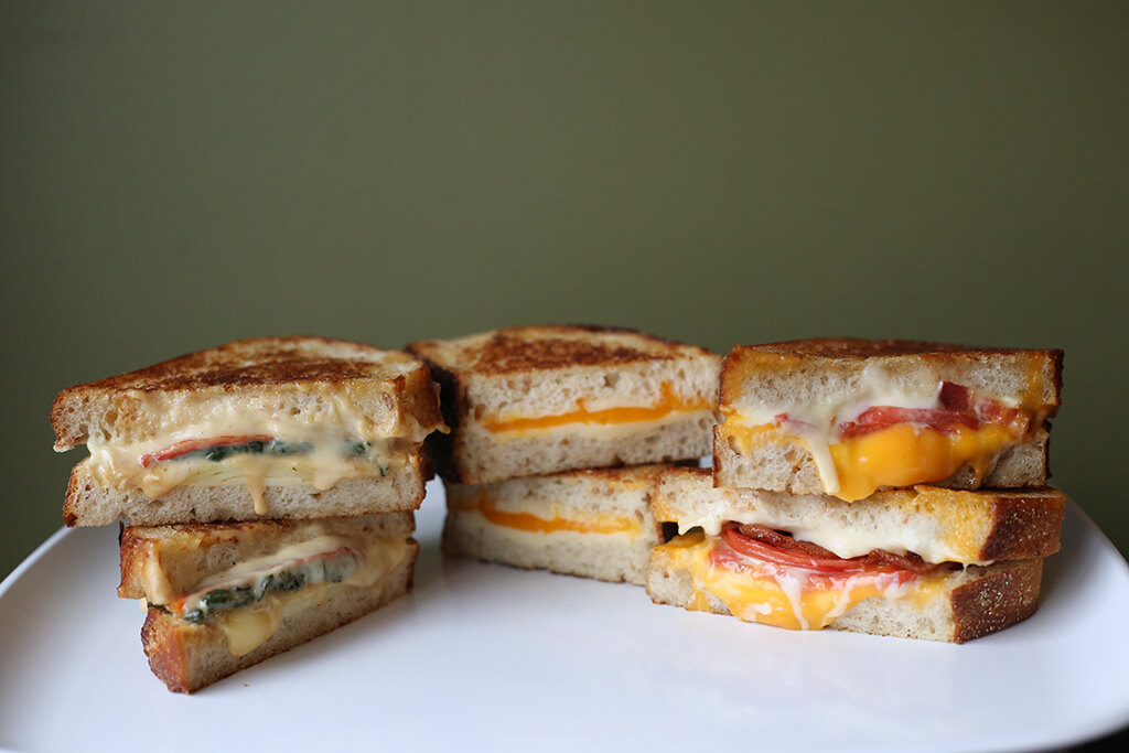 clun sandwiches with meat, veggies and cheese
