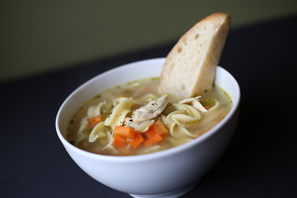 chiken noodle soup and bread